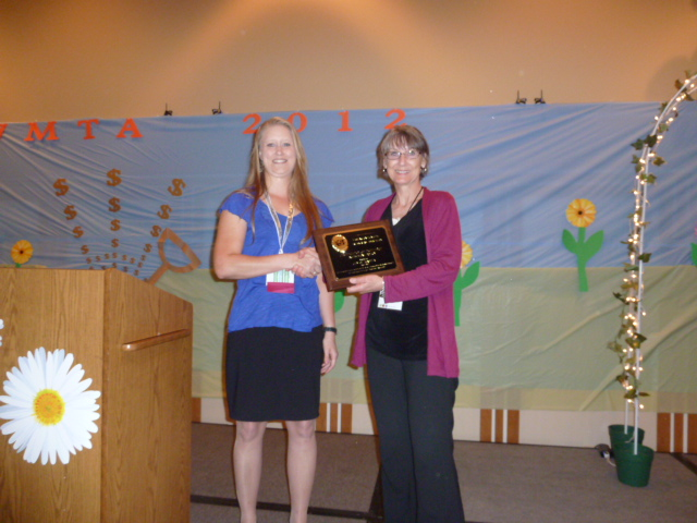 Investment Award Presented by Nicole Muegge to Peggy McCarthy, City of Tukwila